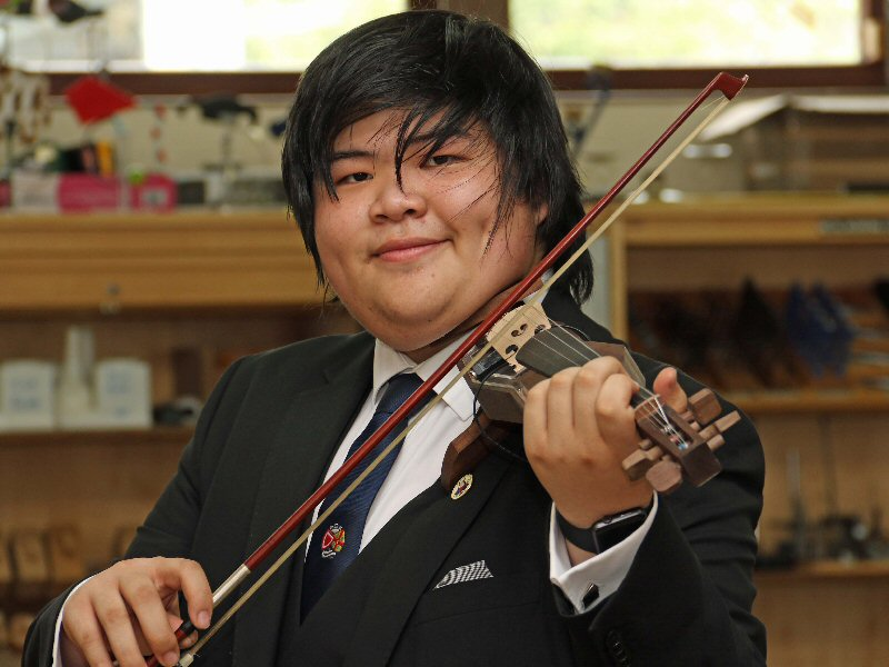 Student adds a new string to his bow