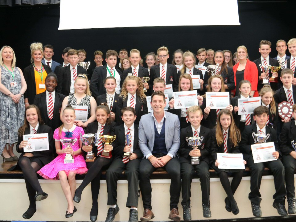 Wyvern Academy students are presented with sports awards by team GB athlete
