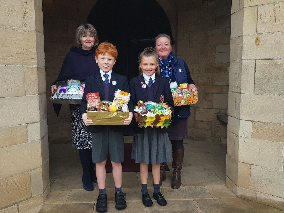 Pupils collect a bounty of fruit, food, flowers and felicitations