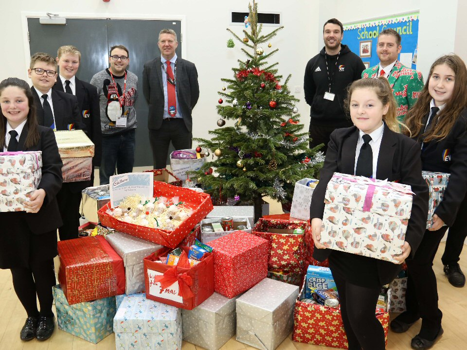Pupils at Haughton Academy donate a harvest of treats to foodbank