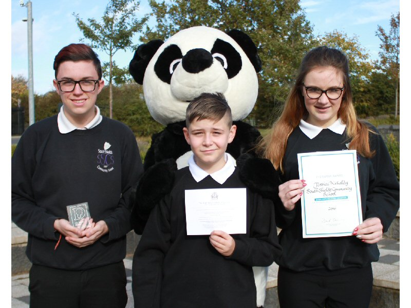 Anti-bullying students collect award
