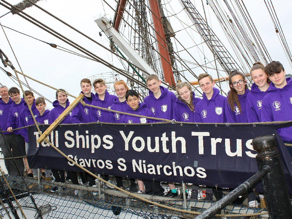 Hearty crew of students from Emmanuel College return from voyage of adventure